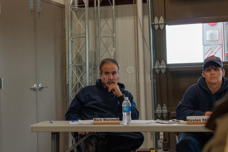 Contentious meeting on 02-13-2018 in small rural town of Julian in San Diego county, Julian Volunteer Fire Department board meetin. A thoughtful fire chief Rick stock photos