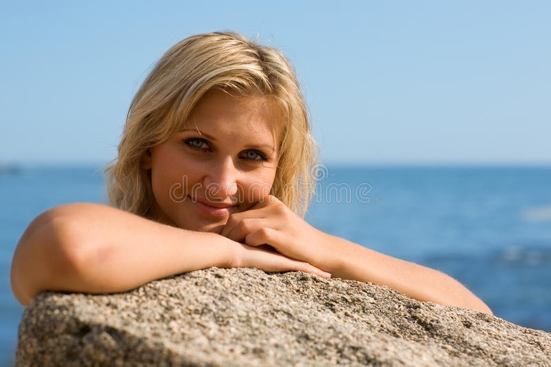 Thoughtful girl on the beach. By the sea stock images