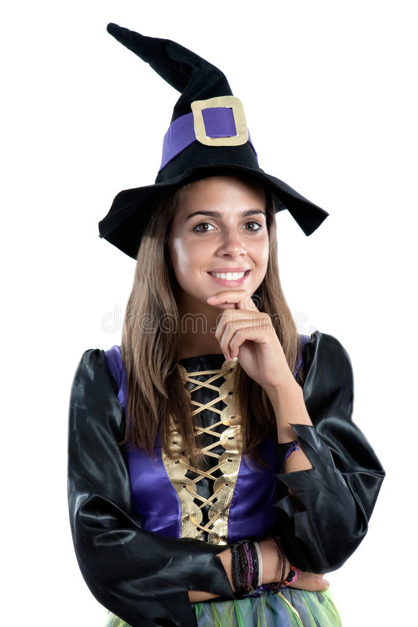 Thoughtful girl dressed in witch. Isolated on white background stock photos