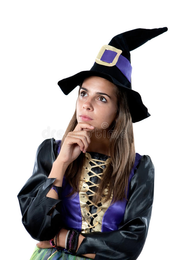 Thoughtful girl dressed in witch. Isolated on white background royalty free stock photography