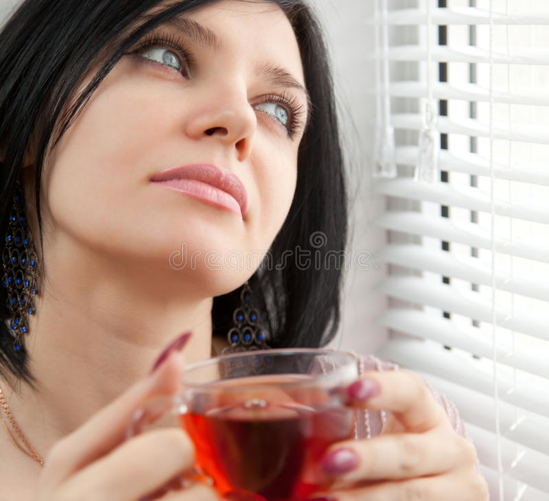 Download Thoughtful Girl Drinking Tea At The Window Stock Image - Image: 18205519