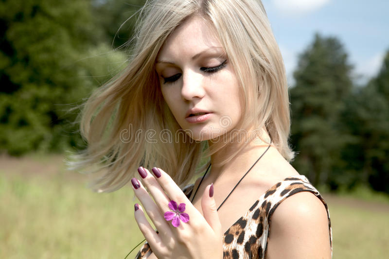 Download The Thoughtful Girl With A Field Flower Stock Photo - Image: 14863910