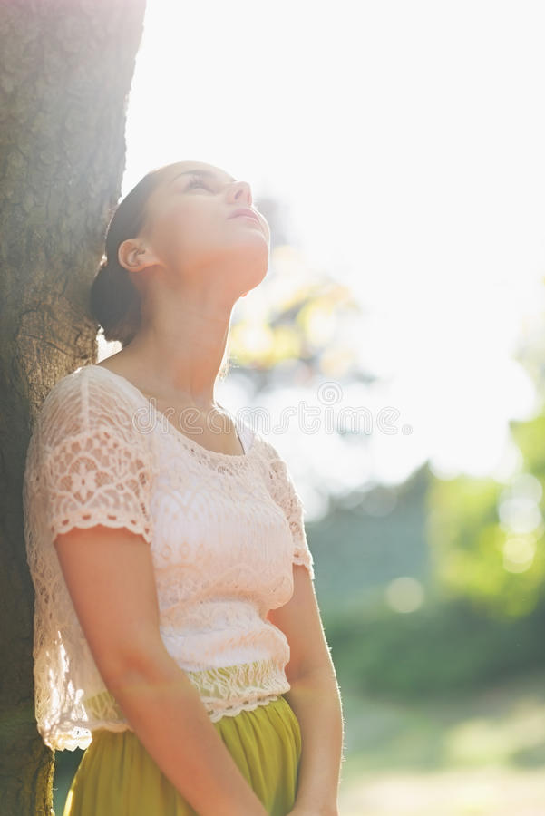 Download Thoughtful Girl Lean Against Tree Stock Photo - Image of pretty, girl: 26381682