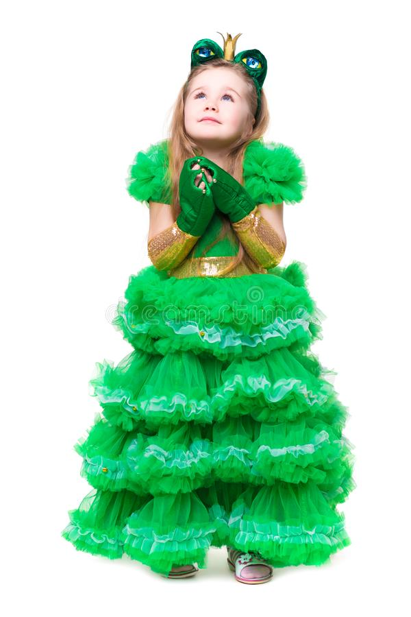 Thoughtful girl posing in frog suit royalty free stock images