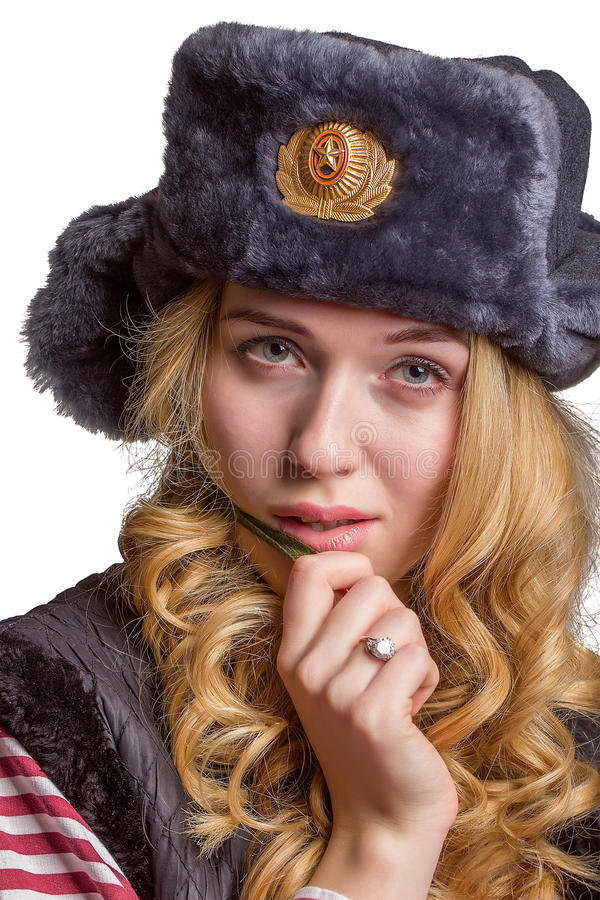 Thoughtful girl in a soldier's cap royalty free stock photos
