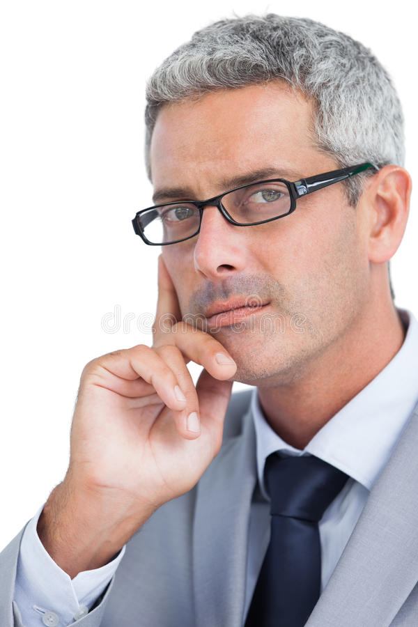 Thoughtful handsome businessman wearing glasses stock photography