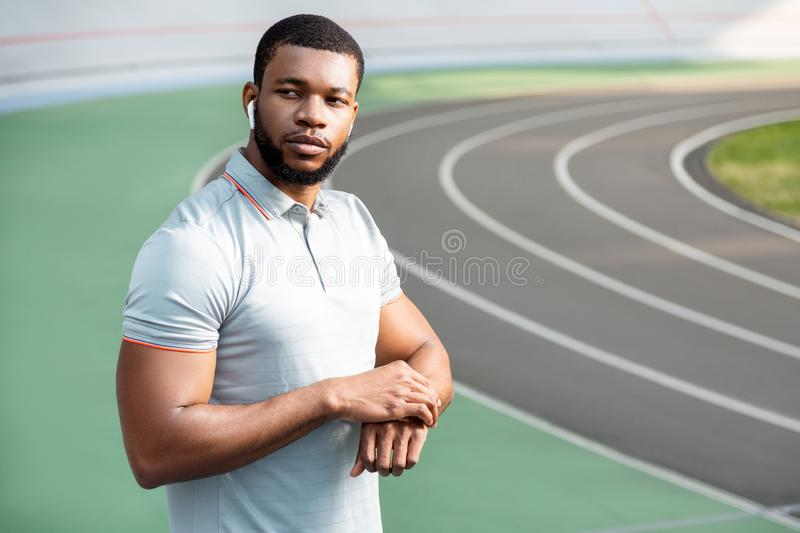 Thoughtful handsome young sportsman looking into the distance royalty free stock photo