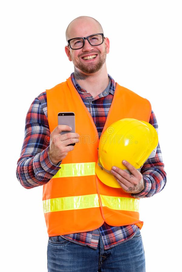 Young bald muscular man construction worker stock photo
