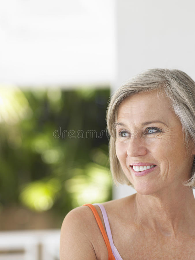 Thoughtful Happy Middle Aged Woman Looking Away royalty free stock photo
