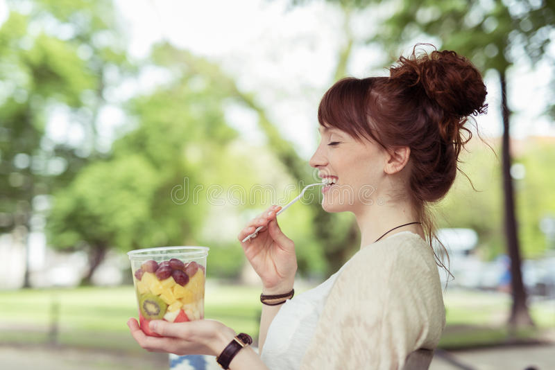 Thoughtful Lady Eating Fresh Healthy Fruit Salad royalty free stock photography