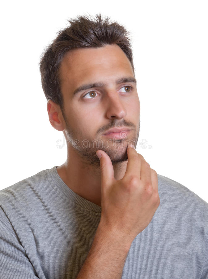 Thoughtful latin man. Latin man with stubble looks thoughtful royalty free stock photography