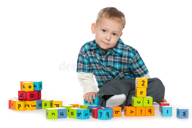 Thoughtful little boy with blocks royalty free stock photos