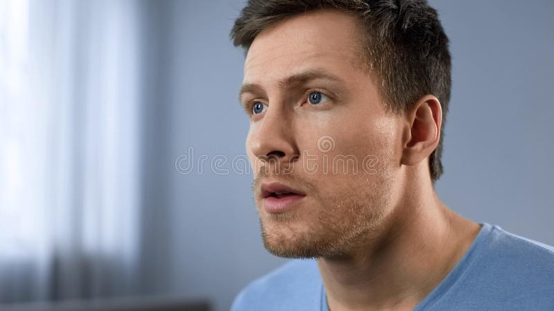 Thoughtful look of adult male, face expressing hope, anticipation, new idea. Stock photo stock photography