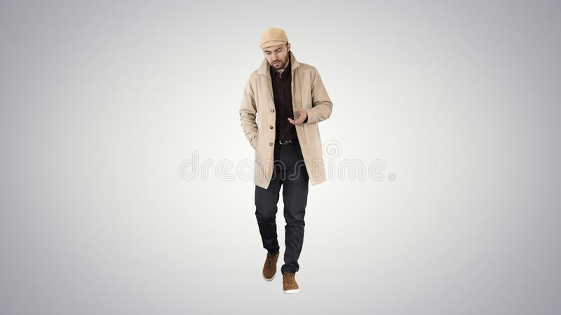 Thoughtful look Man walking and talking to himself on gradient background. stock photography