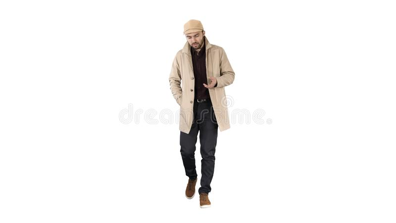 Thoughtful look Man walking and talking to himself on white background. stock photo