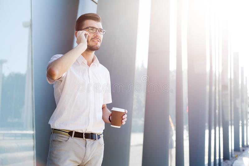 Thoughtful man making a phone call outdoors royalty free stock image
