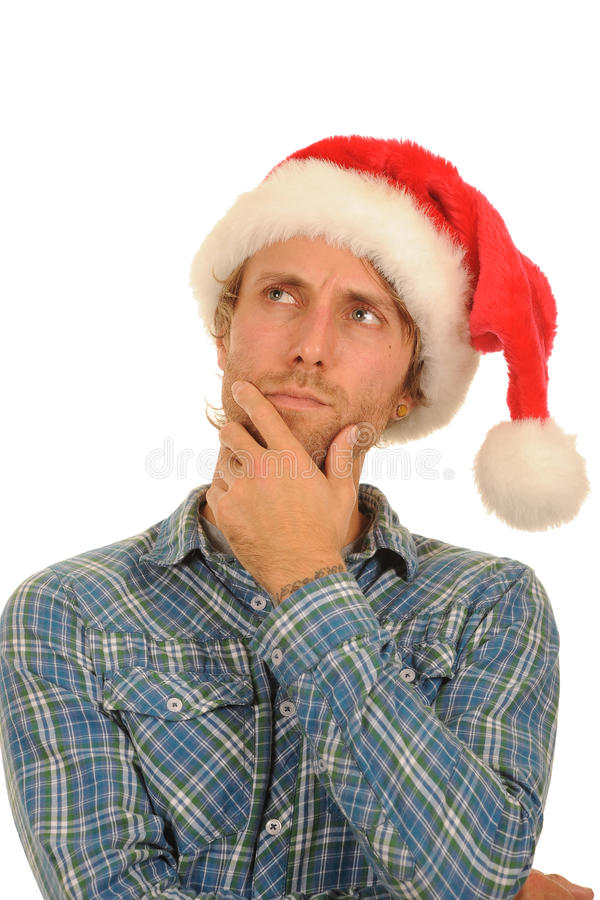 Thoughtful man in Santa hat. Thoughtful young man in Santa hat; isolated on white background royalty free stock photos
