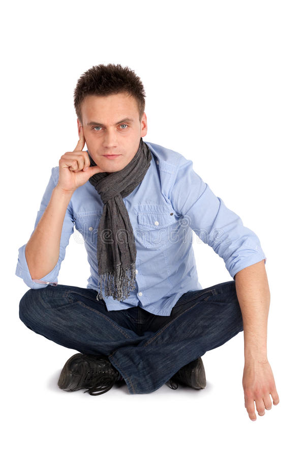 Thoughtful Man Sitting With Legs Crossed Stock Photo ...