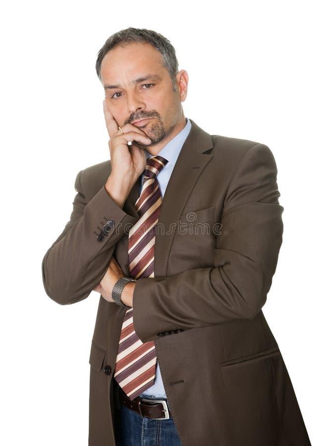 Thoughtful mature businessman on white background stock image