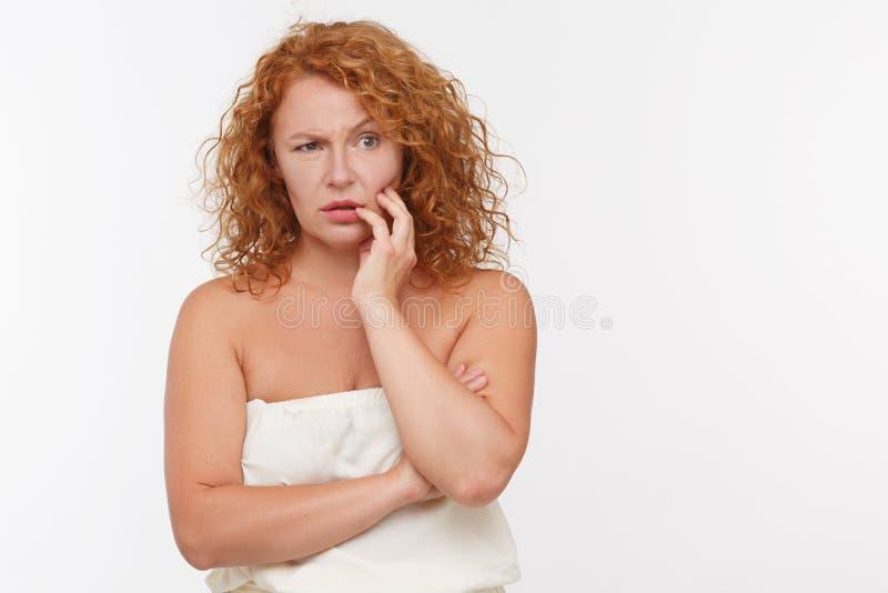 Thoughtful mature woman stock image