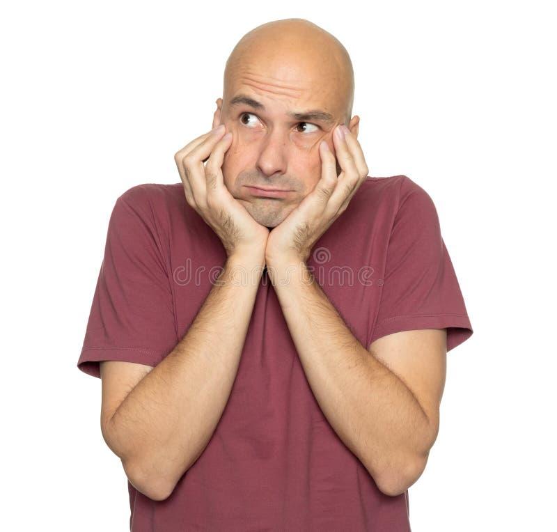Thoughtful middle aged bald man thinking stock photos