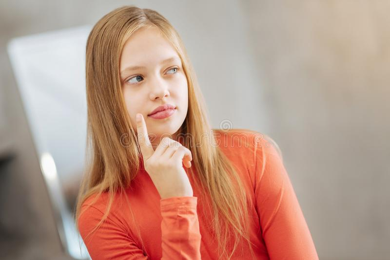 Download Thoughtful Nice Girl Toughing Her Cheek Stock Photo - Image of child, face: 104799886