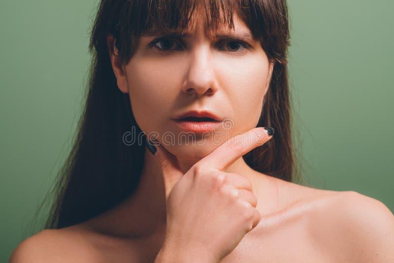 Thoughtful pensive beautiful girl portrait stock photos