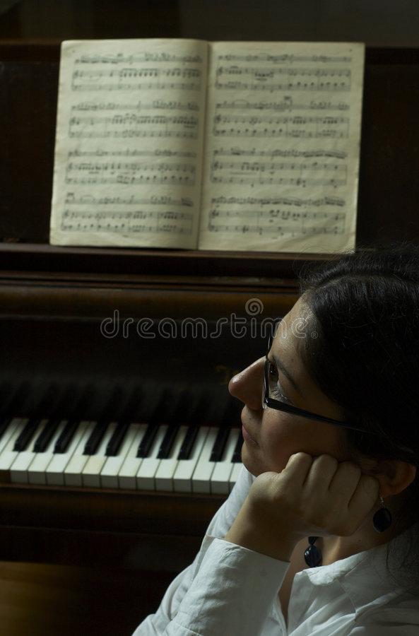 Download Thoughtful Piano Teacher stock photo. Image of compete - 1721852