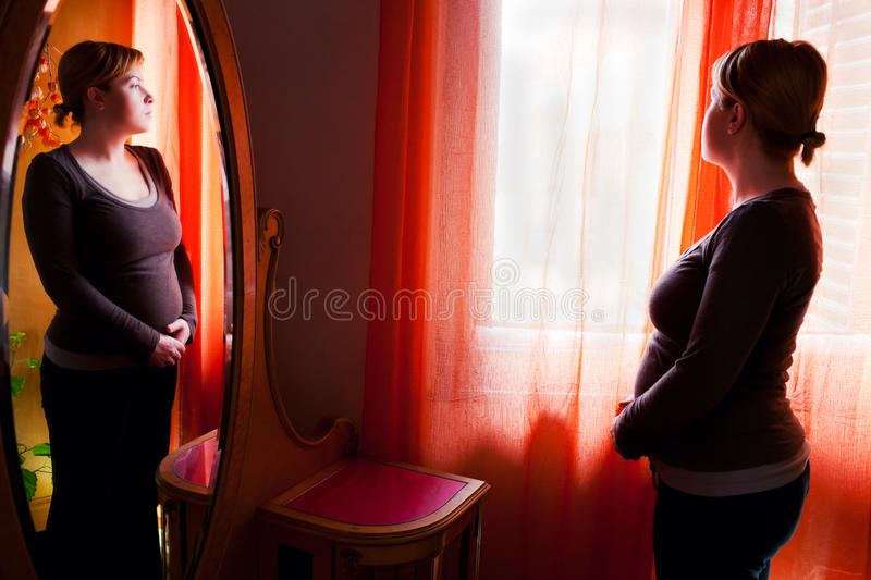 Thoughtful pregnant woman stock image