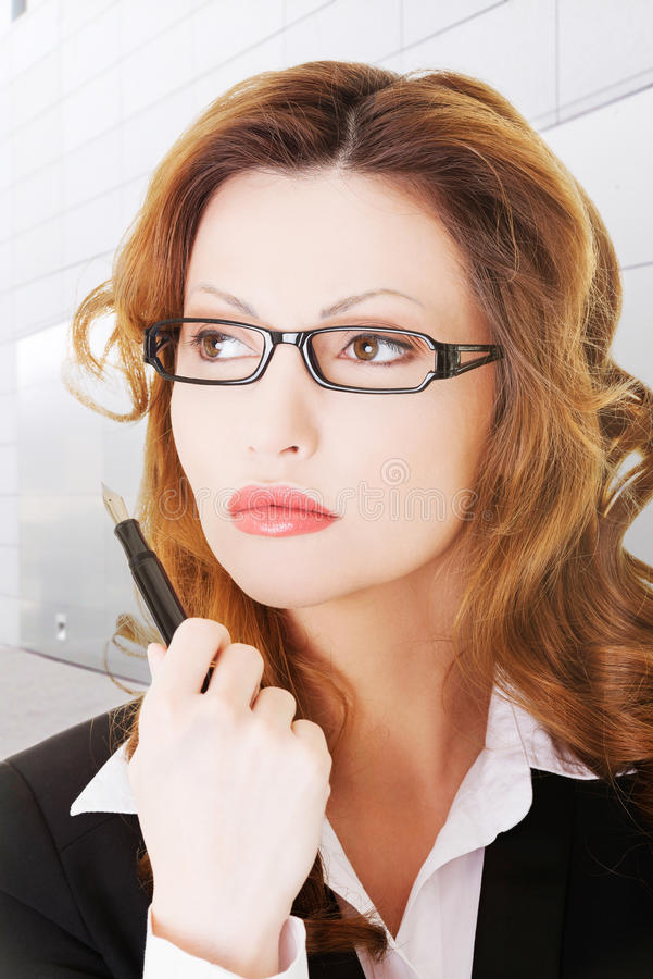 Thoughtful Pretty Businesswoman Royalty Free Stock Image