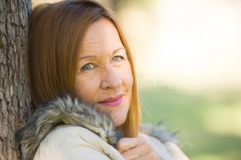 Thoughtful relaxed attractive mature woman stock images
