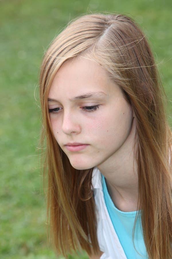 Thoughtful sad teenage girl royalty free stock photography