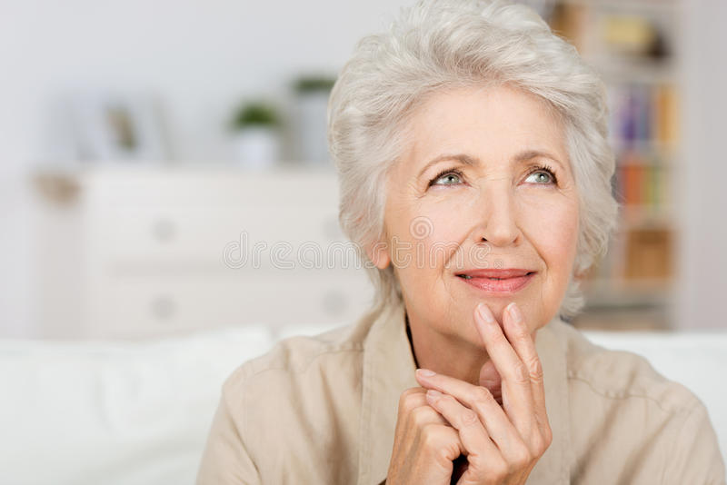 Thoughtful senior lady royalty free stock image
