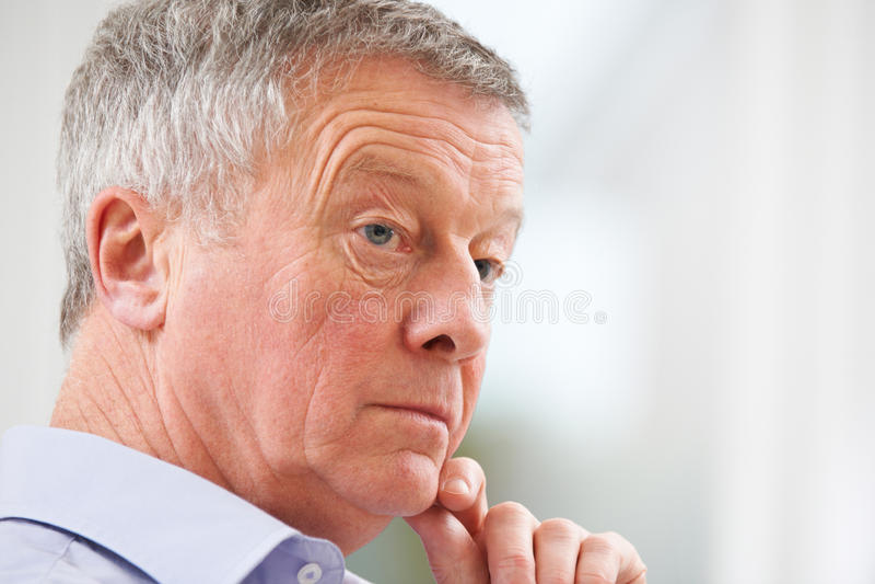 Thoughtful Senior Man At Home stock photos