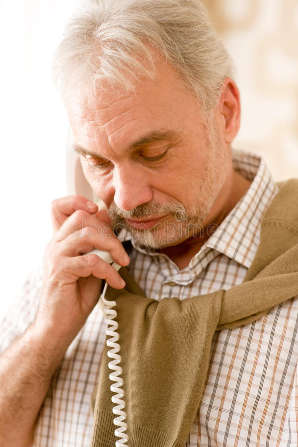 Thoughtful senior mature man call on phone royalty free stock images