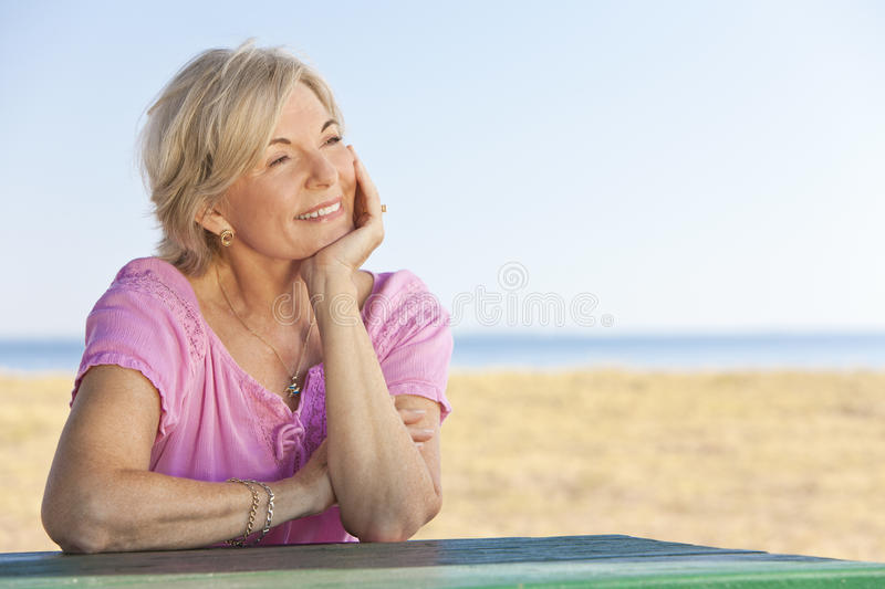Download Thoughtful Senior Woman Sitting Outside At Table Stock Photo - Image: 19992606