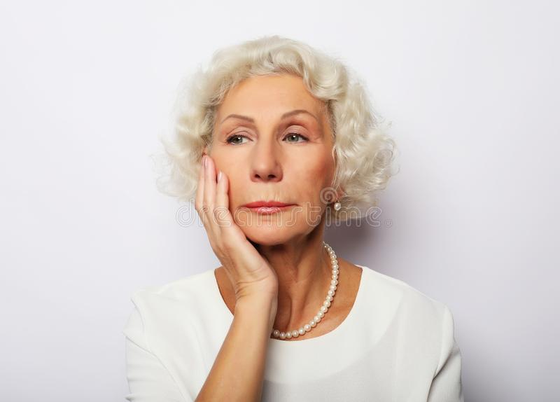 Thoughtful serious senior woman feeling blue worried about problems royalty free stock photo