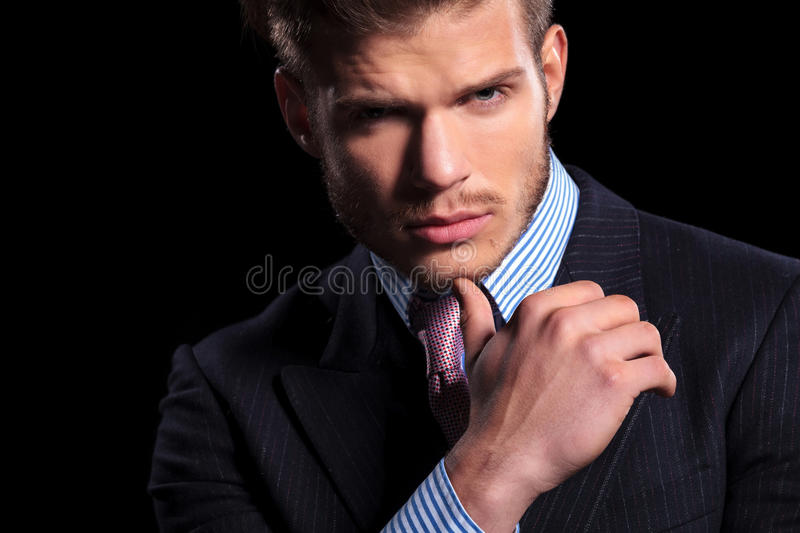 Thoughtful serious young business man royalty free stock photography