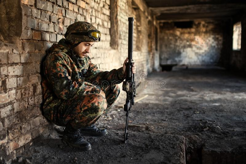 A thoughtful soldier, resting from a military operation stock photos