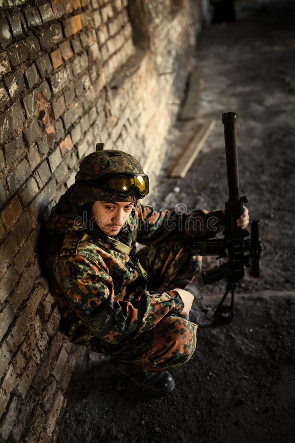 A thoughtful soldier, resting from a military operation royalty free stock image