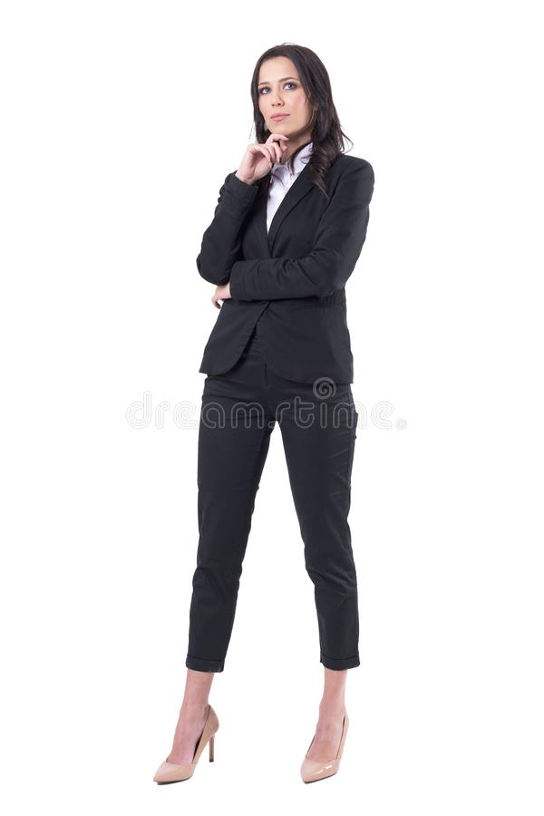 Thoughtful successful business woman looking up having idea. Full body isolated on white background stock photo