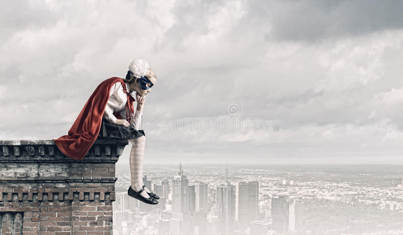 Thoughtful superkid stock photography