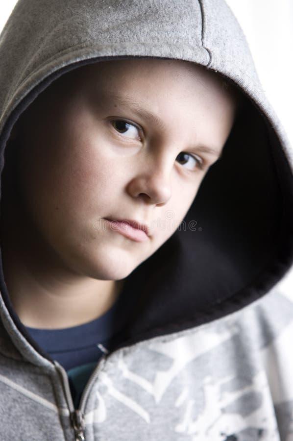 Thoughtful teenage boy stock photography