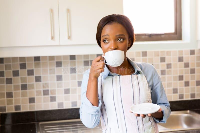 Thoughtful woman drinking coffee stock photos