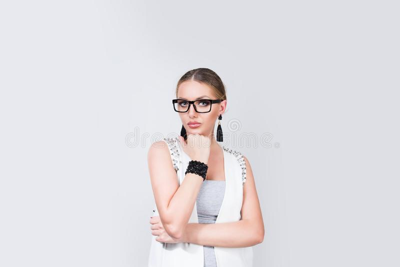 Thoughtful woman in glasses leaning on hand stock images