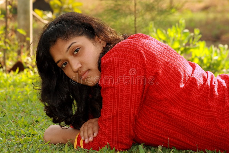 Download Thoughtful woman on grass stock photo. Image of worried - 6011074