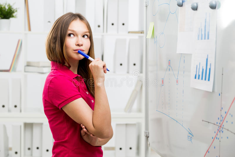 Thoughtful woman in office royalty free stock photos