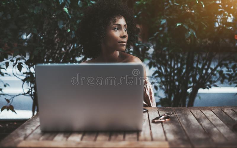 Woman with a laptop in a street bar stock photography