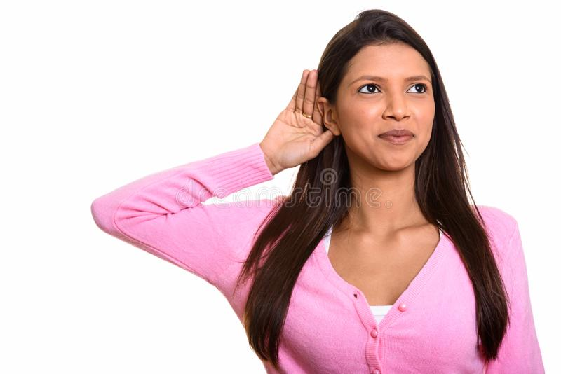 Thoughtful young beautiful Brazilian woman listening and smiling royalty free stock image