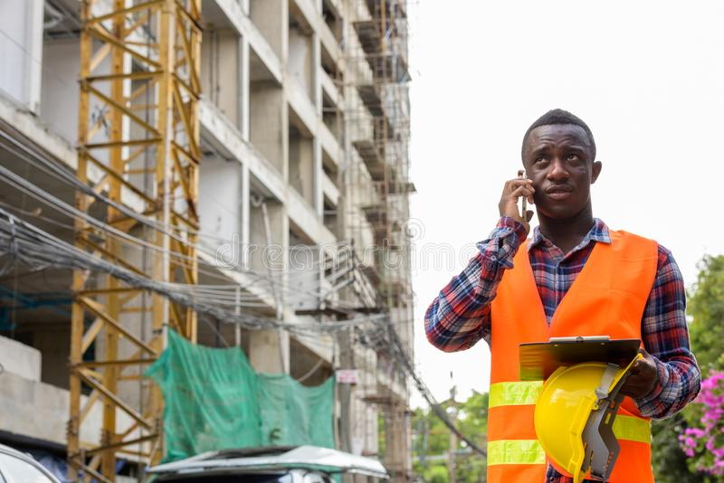 https://thumbs.dreamstime.com/b/thoughtful-young-black-african-man-construction-worker-talking-o-thoughtful-young-black-african-man-construction-worker-talking-130657340.jpg